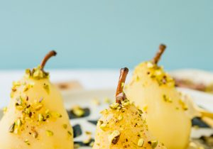 Boozy Poached Pears with Honey and Pistachios Recipe